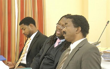 (from left) Brian Clarke and Selwyn Peters, both representing the Guyana Trades Union Congress at the CoI into the 1980 killing of Dr. Walter Rodney.