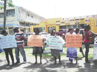 Protesters yesterday along the Main Street Avenue opposite the Ministry of Culture, Youth and Sport, calling for an independent investigation of recent reports of sexual abuse of New Opportunity Corps (NOC) inmates.