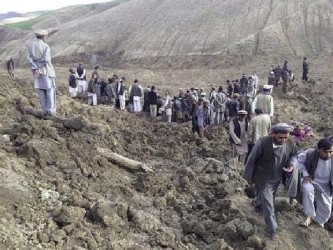 Afghan villagers gather at the site of a landslide at the Argo district in Badakhshan province, May 2, 2014. REUTERS/Stringer