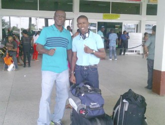 Thumbs Up! Clive Atwell and Coach, Lennox Daniels took a photo for Stabroek Sport yesterday at the CJIA before departing for the US.
