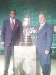 CONCACAF president Jeff Webb (left) poses with South American counterpart Eugenio Figueredo, and the Copa America trophy.