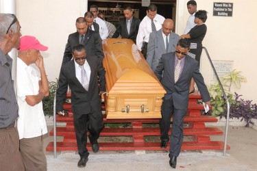 Pall bearers exit the Bethel Gospel Hall with Ronald Webster's casket after the funeral service yesterday.