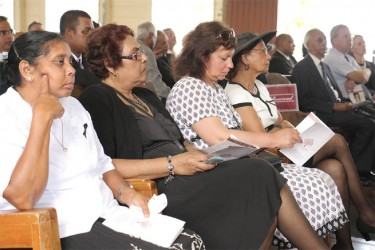 Bibi Webster (first, right) among relatives at her husband's funeral yesterday.