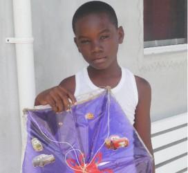 Elijah Todd shows off his kite