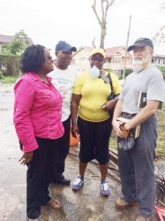 Politician and social activist Dr Faith Harding (left) and Mexican Ambassador to Guyana Francisco Olguin (right) flank GWMO President Simona Broomes and a volunteer at last Sunday's clean-up exercise.