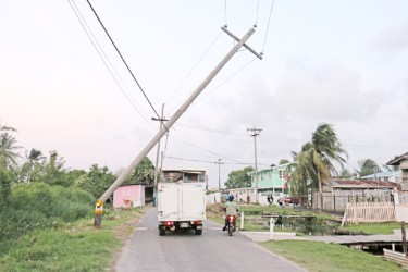 Disaster waiting to happen: This broken electricity pole at Dairy Farm Road, Sophia is being held up by a telephone cable. (Photo by Arian Browne)