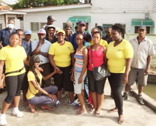 GWMO President Simona Broomes with other members of the GWMO and inmates of the Georgetown Prison after last Sunday's clean up.