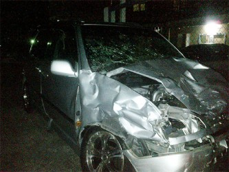 One of the damaged Raums parked at the Grove Police Station after the accident