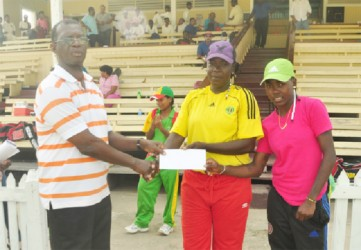 Female winners Shemaine Campbell and Irva Giddings collect their GY$100, 000 check from GCB Competitions Chairman Colin Europe