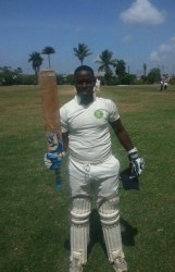 MSC, Nichosie Barker raises his bat after scoring a century against GYO.
