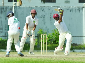 Berbician Balchand Baldeo executes a cover drive yesterday at the GCC Ground