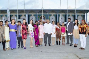 President Donald Ramotar and Minister of Tourism, Industry and Commerce, Irfaan Ali being welcomed by young Guyanese decked out their traditional wear at the launch of the Guyana Festival (GINA photo)