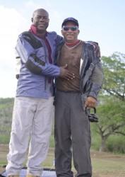 Lennox Braithwaite being congratulated by Guyana's Captain Mahendra Persaud