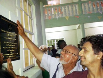 Unveiling: Bollywood singer Sonu Nigam and President Donald Romotar unveil the commemorative plaque at the opening of Bal Nivas, a state-of-the-art housing facility in Berbice for abuse victims. (David Papannah Photo)
