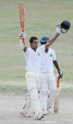 Opener Tagenarine Chanderpaul celebrates his unbeaten hundred yesterday at the GCC ground.