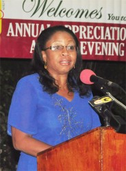 Justice, Roxanne George delivering her feature address at the GOA's Annual Appreciation and Awards Ceremony which was held Friday night at the Georgetown Club. (Orlando Charles photo)