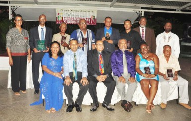 The awardees of the GOA's Annual Appreciation and Awards Ceremony are flanked by Prime Minister, Samuel Hinds and Minister of Sport, Dr. Frank Anthony. (Orlando Charles photo)