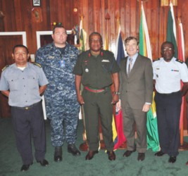 Army Chief of Staff Brigadier Mark Phillips and US Ambassador Brent Hardt (third and fourth from left) are flanked by Coast Guard Capt John Flores (first, left) US Lt Com Robert Novotny and another official at a recent meeting.