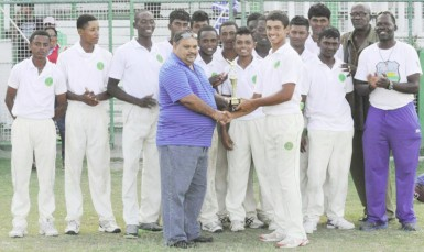 Tagenarine Chanderpaul collects the man-of-the-match trophy from president of the Guyana Cricket Board (GCB) Drubahadur.