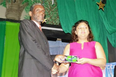 Minister of Education Priya Manickchand (right) accepts a digital copy of the five new CAPE syllabuses from Acting Registrar of CXC Glenroy Cumberbatch. The subjects: Agricultural Science, Entrepreneurship, Performing Arts, Physical Education and Sport, and Tourism will be offered within the Caribbean from September.