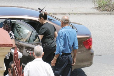 Carol Ann Lynch entering a taxi followed by her father Robert Lynch (right).