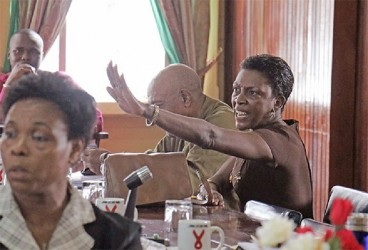 Talk to the hand: PNC Councillor Monica Thomas during the verbal altercation with PPP Councillor Kamla Devi Ross yesterday at City Hall.