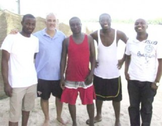 Lawrence Lachmansingh (second from left) and Horatio Nii Dodoo (centre) standing on the beach with the others. The river is in the background. (photo: Francis Quamina Farrier via Guyanese Online)