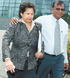 Nyree Alfonso, left, former chairman of First Citizens Bank, leaves the National Academy of the Performing Arts (NAPA), Port-of-Spain, with her husband Towfeek Ali, after publicly resigning the position during the bank's annual general meeting on Monday. (Trinidad Guardian photo)