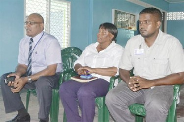 From Left, Chief Executive Officer of the Guyana Power and Light Company, Bharat Dindyal, Project Engineer of the Mahaicony Substation, Gail Best and Area Engineer, Onverwagt, Subash Mipal during the outreach meeting with residents. (GINA photo)
