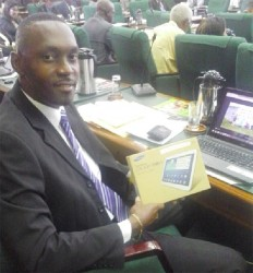 APNU Member of Parliament Christopher Jones holds the Samsung Tablet he received.