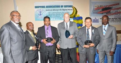 At the shipping association's dinner and awards ceremony: Shipping Association Chairman Desmond Sears (left) with 2014 individual and group awardees Ian D'Anjou, Kamal Singh, Chris Fernandes, Robin Muneshwer and Barbados Port Authority Head  David Jean-Marie
