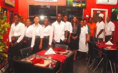 At the ready: Staff of the newly opened Midtown Chariot Hotel and Resturant on duty on Tuesday evening