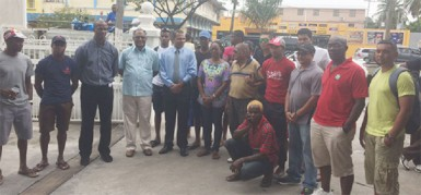 Minister of Sport, Dr. Frank Anthony (fifth from left) poses with the organizers and some of the cyclists competing in the Independence Three-Stage Road Race following the formal send off at his Main Street ministry yesterday.