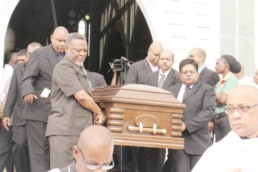 Prime Minister Samuel Hinds and Finance Minister Dr Ashni Singh among pall bearers as Williams's casket left the St George's Cathedral after the funeral service. (Photo by Arian Browne)