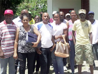 The workers standing in the yard of the union after they said they were barred from entering the conference.