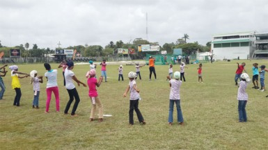 Inga Henry working with some of the players during a softball training session
