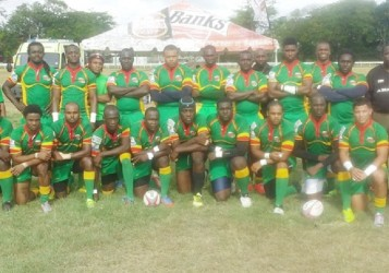 The national 15s rugby squad poses for a picture prior to the game versus Barbados at the Garrison Savannah.