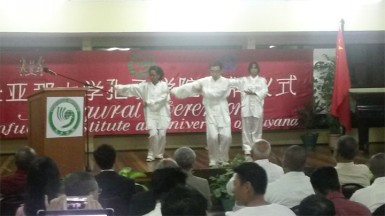 Instructor (centre) and students in a Tai Chi demonstration during the ceremony last night