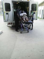 An employee being lifted out of an ambulance.