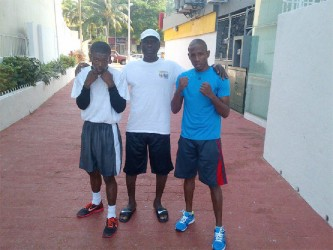 Clive Atwell left after his training session yesterday with trainer Lennox Daniels and training partner Leon Moore.