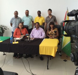 In photo, Director of Fly Jamaica, Roxanne Reece (sitting at left) and Director of Tourism Indranauth Haralsingh (seated at centre) are flanked by the five chefs.