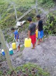 Children fetching water at Paramakatoi (AFC photo)