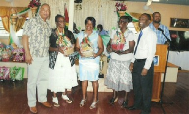 Minister in the Ministry of Finance, Juan Edghill (left) and GTU president, Mark Lyte (right) with three of the awardees