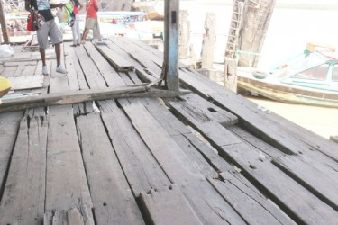 Some of the rotten planks that commuters and vendors have to walk on at the Stabroek Market.