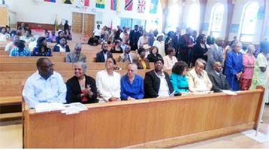 This photo shows Guyanese and other members of the Parish of St. Gabriel's Church during the Communion period.  L to R: Bobby Vieira (broadcaster), Ave Brewster-Haynes (former General Manager of the GBC), Molly Berry – Executive Officer at the Guyana Consulate New York, Gloria Robertson - Sister of President Donald Ramotar,  Yvonne Marcus – Member of the Guyana Tri-State Alliance, Pat Jordon-Langford – President of the Guyana Tri-State Alliance, Claire Goring – Cultural Director of the Guyana Cultural Association of New York & Guyana's Consul General in New York – Brentnol Evans.