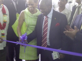 St. Kitts and Nevis Prime Minister Denzil Douglas along with Dr. Anne-Marie Irvine Smith, wife of the CDB President Warren Smith, cutting the ribbon to formally open the new Tuschen Nursery School.