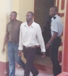 Wesley Morrison (R) and Royston Herod (L) being escorted to the holding cells