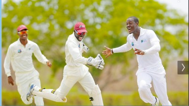 Sagicor WI HPC captain Kraigg Brathwaite, left, wicketkeeper Chadwick Walton and seamer Carlos Brathgwaite, right celebrate another Bangladesh A wicket on the second day of the first four day match between the two sides at the Windward Sports Club. (Photo by WICB media/Randy Brooks of Brooks/La Touche photography.