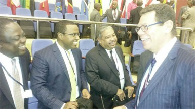 CDB President Dr Warren Smith (right) speaking to delegates yesterday.
