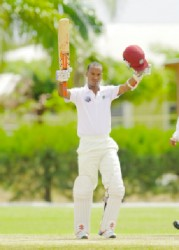 Kraigg Brathwaite of the High Performance Centre XI celebrates reaching his century yesterday, the third day of the four day match against Bangladesh A  at the Windward Sports Club in Barbados yesterday. Photo by WICB media/Randy Brooks of Brooks La Touche photography.